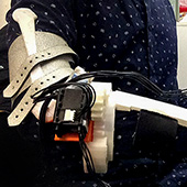 Exoskeleton to stop tremor of people with Parkinson